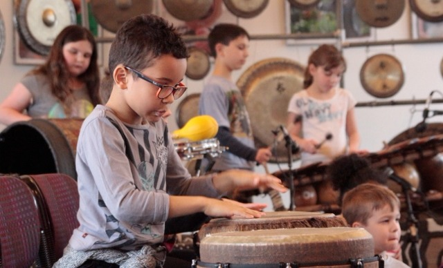 Elementary student drumming