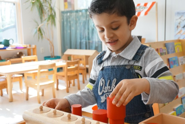 Primary Student with Montessori Materials